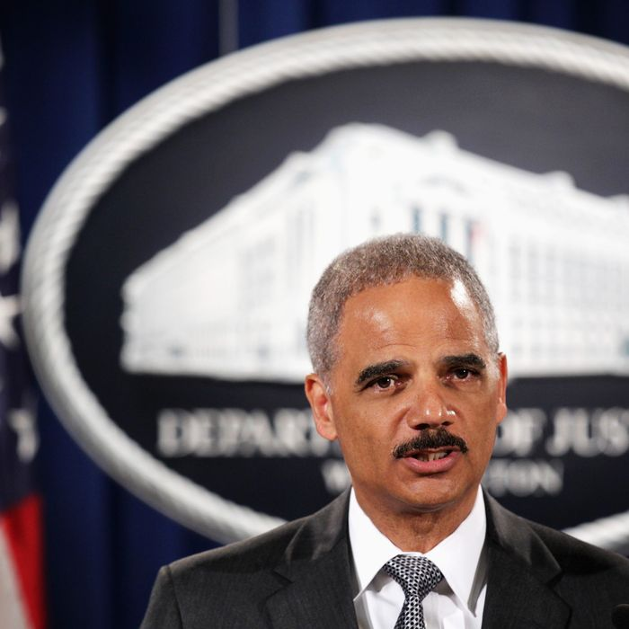 WASHINGTON, DC - AUGUST 21: Attorney General Eric Holder makes a separated statement on the unrest after the unarmed 18-year-old Michael Brown was shot by a police officer in Ferguson, Missouri, during a major financial fraud announcement press conference August 21, 2014 at the Justice Department in Washington, DC. Holder spoke on the current situation in Ferguson one day after his visit to the town and met with Brown's family, saying the investigation of the shooting will be thorough and will be fair, and Department of Justice stands with the people of Ferguson. (Photo by Alex Wong/Getty Images)
