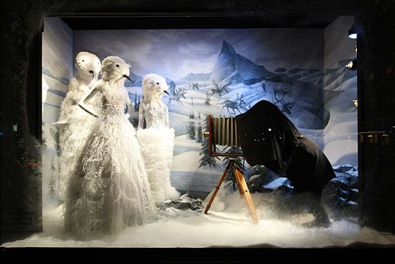 "Bergdorf Goodman's 2011 windows, entitled ""Carnival of the Animals,"" features different settings and animals reimagined in various materials such as brass, leather, and paper."