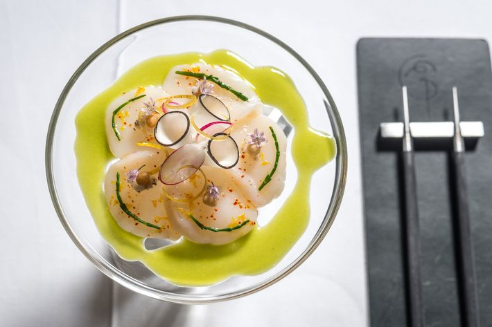 Raw marinated diver scallop with jalapeño coulis, black radish, and Meyer-lemon confit.