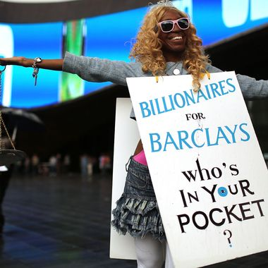 NEW YORK, NY - SEPTEMBER 28:  A protester stands in front of the new Barclays Center on opening night, which was to feature recording artist Jay-Z on September 28, 2012 in the Brooklyn borough of New York City. Dozens of protesters and curious onlookers converged on the new arena which caused debate and controversy when it was originally proposed nine years ago. The $1 billion arena will bring a professional sports team, the Brooklyn Nets, back to Brooklyn for the first time in more than a half-century.  (Photo by Spencer Platt/Getty Images)