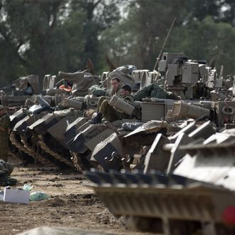 Israeli soldiers sit atop their armoured personnel carriers (APC) stationed on Israel's border with the Gaza Strip on November 16, 2012. Israeli officials said the Jewish state was preparing to launch its first ground offensive in four years into the Gaza Strip and the army started calling up reservists.