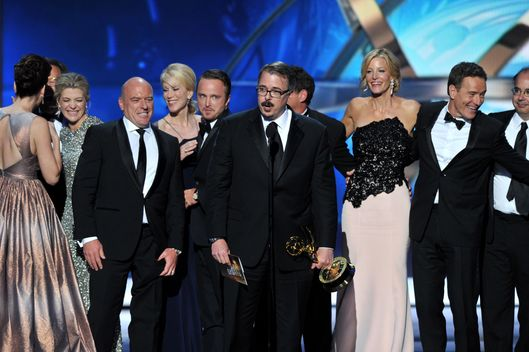 "Vince Gilligan, center, and the cast and crew of ""Breaking Bad"" accept the award for outstanding drama series at the 65th Primetime Emmy Awards at Nokia Theatre on Sunday Sept. 22, 2013, in Los Angeles.  (Photo by Vince Bucci/Invision for Academy of Television Arts & Sciences/AP Images)"