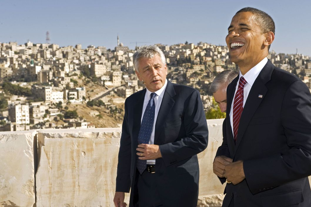 US Democratic presidental candidate Barack Obama (R) shares a laugh with US Senator Chuck Hagel R-Neb., as they tour the Citadel on July 22 2008, with the hillsides of Amman in the background. Illinois Senator Obama continues his tour across the Middle East and then on to Europe. US Senator Jack Reed D-R.I., is obscured in the center.
