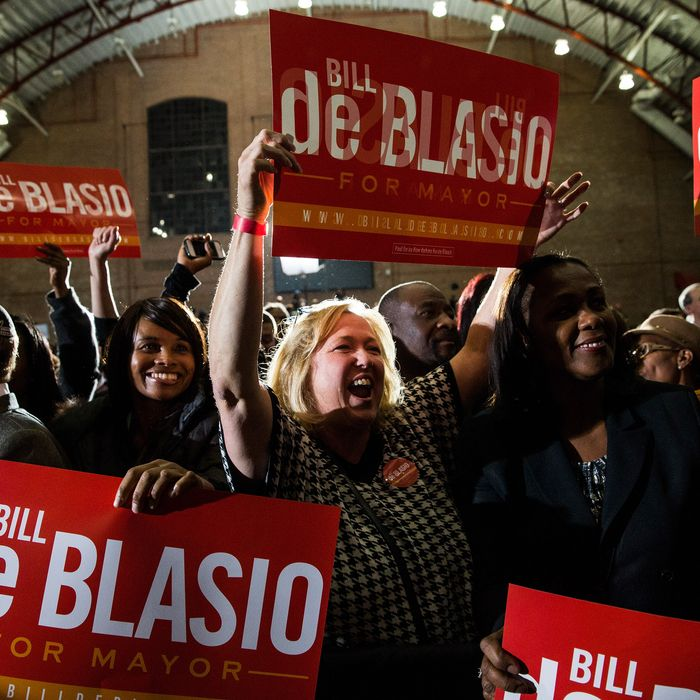 NEW YORK, NY - NOVEMBER 05: Lori Zeno (C), a supporter of newly elected New York City Mayor Bill de Blasio, waves a sign while waiting for de Blasio to walk out at his election night party on November 5, 2013 in New York City. De Blasio beat out Republican candidate Joe Lhota and will succeed Michael Bloomberg as the 109th mayor of New York City. He is the first Democratic mayor in 20 years. (Photo by Andrew Burton/Getty Images)