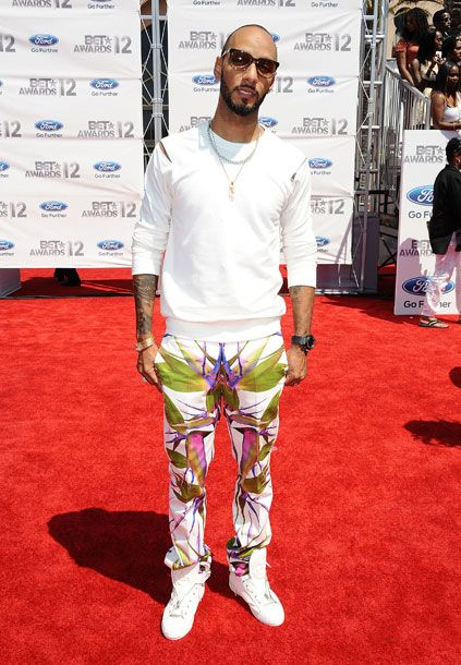 "He's wearing <a href=""http://nymag.com/daily/fashion/2012/06/best-and-worst-of-june-fashion-magazines.html#photo=22x00012"">these pants</a>! Also, perhaps in the spirit of ventilation, he's left one shoulder zip undone (that counts as a cutout, no?)."