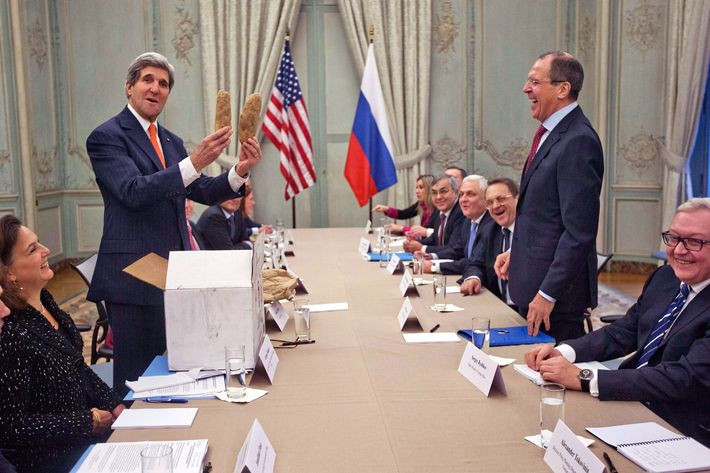 US Secretary of State John Kerry (L) holds Idaho potatoes  as a gift for Russia's Foreign Minister Sergey Lavrov (2R) before the start of their meeting at the US Ambassador's residence in Paris, on January 13, 2014. Kerry, his Russian counterpart Sergei Lavrov and UN-Arab League envoy on Syria will meet for talks aimed at finalising preparations for hoped-for peace talks between Bashar al-Assad's regime and the opposition National Coalition. AFP PHOTO/POOL/PABLO MARTINEZ MONSIVAIS        (Photo credit should read PABLO MARTINEZ MONSIVAIS/AFP/Getty Images)