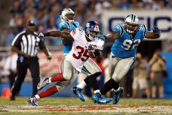 CHARLOTTE, NC - SEPTEMBER 20:  Andre Brown #35 of the New York Giants runs the ball in the first half against Gary Barnidge #82 of the Carolina Panthers at Bank of America Stadium on September 20, 2012 in Charlotte, North Carolina.  (Photo by Streeter Lecka/Getty Images)