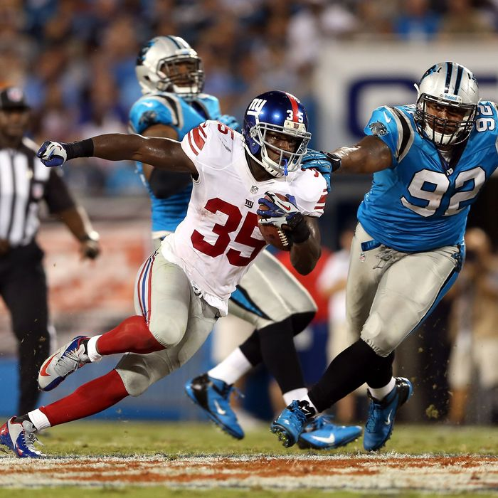 Andre Brown #35 of the New York Giants runs the ball in the first half against Gary Barnidge #82 of the Carolina Panthers at Bank of America Stadium on September 20, 2012 in Charlotte, North Carolina.