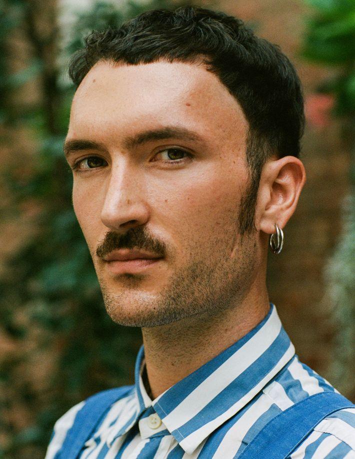 Man piercing left ear
