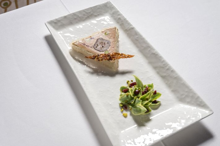 Foie-gras-and-rabbit-loin terrine with muscat gelée and five-pepper craquelin.