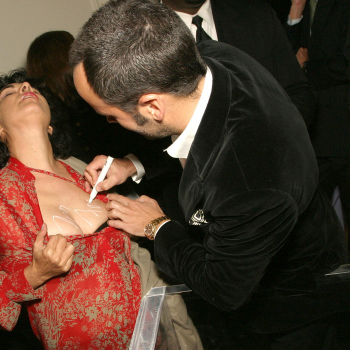 The designer autographs the artist Tracey Moffatt at Bergdorfs in 2004.