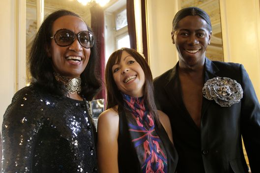 Fashion designer Fatima Lopes, center, poses with TV fashion presenter Vincent Mcdoom, left and J. Alexander, known also as Miss J, is an American model, television personality, backstage prior to her spring-summer 2013 ready to wear collection in Paris, Tuesday, Sept. 25, 2012.  (AP Photo/Francois Mori)