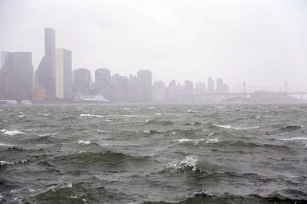 NEW YORK, NY - OCTOBER 29:  Waves pick up on the East River ahead of Hurricane Sandy on eastside of Manhattan on October 29, 2012 in New York City. Sandy, which has already claimed over 50 lives in the Caribbean is predicted to bring heavy winds and floodwaters to the mid-Atlantic region.  (Photo by Michael Heiman/Getty Images)