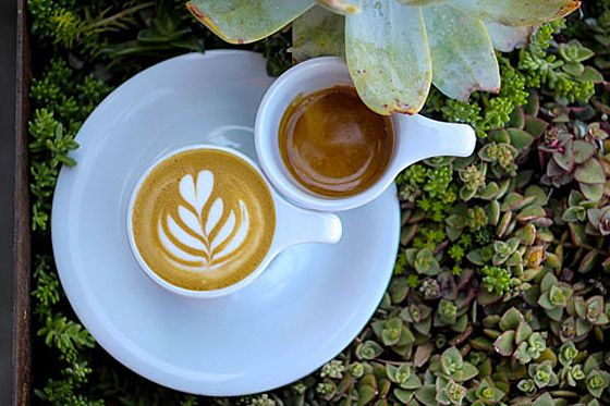 Order the One-and-One: a single macchiato and single espresso placed together on a shared saucer.