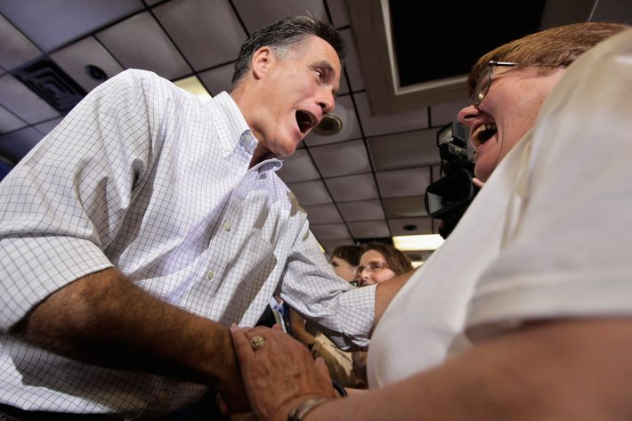 MOLINE, IL - MARCH 18: Republican presidential candidate, former Massachusetts Gov. Mitt Romney greets supporters during a pancake brunch at the American Legion Post 246 March 18, 2012 in Moline, Illinois. Romney is campaigning in Illinois three days before that state's primary elections March 21, when 54 GOP delegates are up for grabs. With Romney in the lead on delegates, fellow candidate, former Pennsylvania Sen. Rick Santorum continues to compete for the 1,444 necessary to secure the nomination before the last primary, in Utah on June 26. (Photo by Chip Somodevilla/Getty Images)