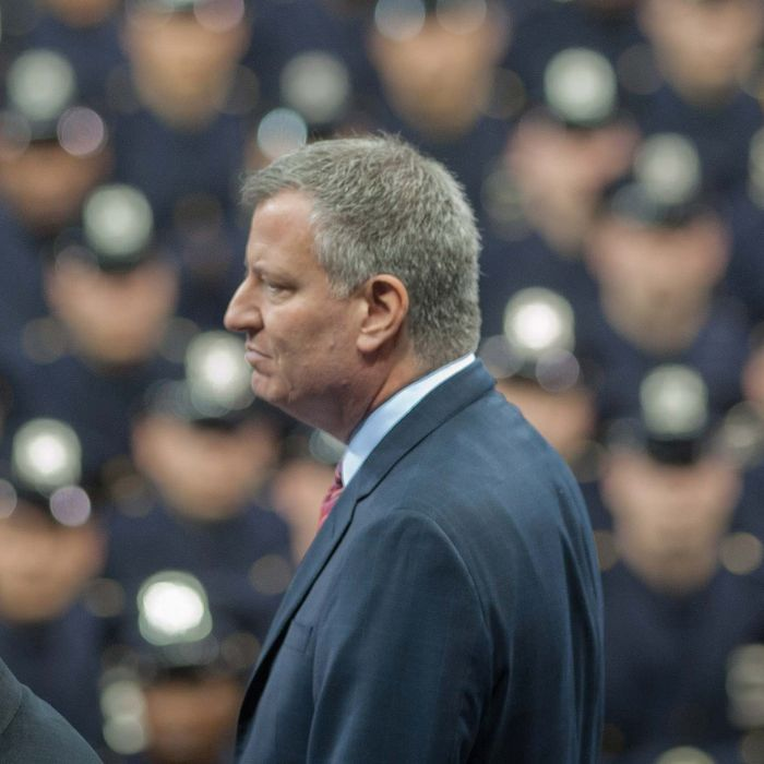 Police Commissioner WILLIAM BRATTON and Mayor BILL DE BLASIO look on at the New York City Police Academy Graduation Ceremony, Madison Square Garden, Mon., Dec. 29, 2014.