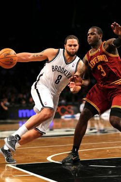 Deron Williams #8 of the Brooklyn Nets heads for the net as Dion Waiters #3 of the Cleveland Cavaliers defends on November 13, 2012 at the Barclays Center in the Brooklyn borough of New York City.The Brooklyn Nets defeated the Cleveland Cavaliers 114-101.