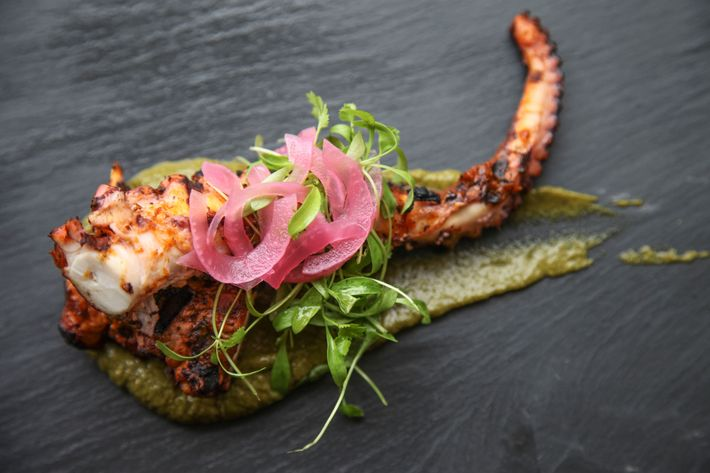 Grilled octopus, pineapple, charred onions, and cilantro coulis.