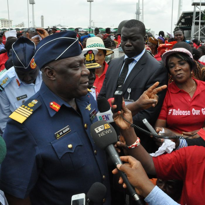 Nigeria's chief of defense staff Air Marshal Alex S. Badeh, centre, speaks during a demonstration calling on the government to rescue the kidnapped girls of the government secondary school in Chibok, in Abuja, Nigeria, Monday, May 26, 2014. Scores of protesters chanting
