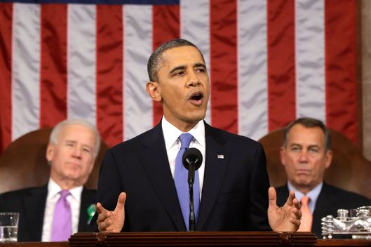 U.S. President Barack Obama, flanked by Vice President Joe Biden and House Speaker John Boehner (R-OH), gestures as State of the Union address during a jointhe gives his session of Congress on Capitol Hill on February 12, 2013 in Washington, D.C. Facing a divided Congress, Obama focused his speech on new initiatives designed to stimulate the U.S. economy.