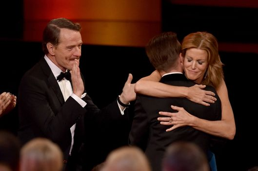 LOS ANGELES, CA - AUGUST 25:  (L-R) Actors Bryan Cranston, Aaron Paul and Anna Gunn celebrate winning Outstanding Drama Series for 'Breaking Bad' onstage at the 66th Annual Primetime Emmy Awards held at Nokia Theatre L.A. Live on August 25, 2014 in Los Angeles, California.  (Photo by Kevin Winter/Getty Images)