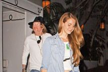 75902, LOS ANGELES, CALIFORNIA - Friday April 6, 2012. Singer Lana Del Rey seen leaving the trendy hangout Chateau Marmont with former Guns and Roses frontman Axl Rose. Photograph: ?Josephine Santos, PacificCoastNews.com **FEE MUST BE AGREED PRIOR TO USAGE** **E-TABLET/IPAD & MOBILE PHONE APP PUBLISHING REQUIRES ADDITIONAL FEES** LOS ANGELES OFFICE:+1 310 822 0419 LONDON OFFICE:+44 20 8090 4079