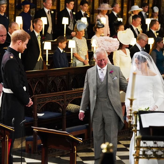 Prince William, Prince Harry, Prince Charles, and Meghan Markle at the royal wedding.