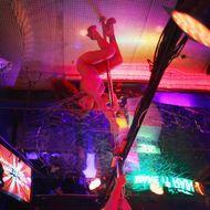 A dancer performs at a strip club