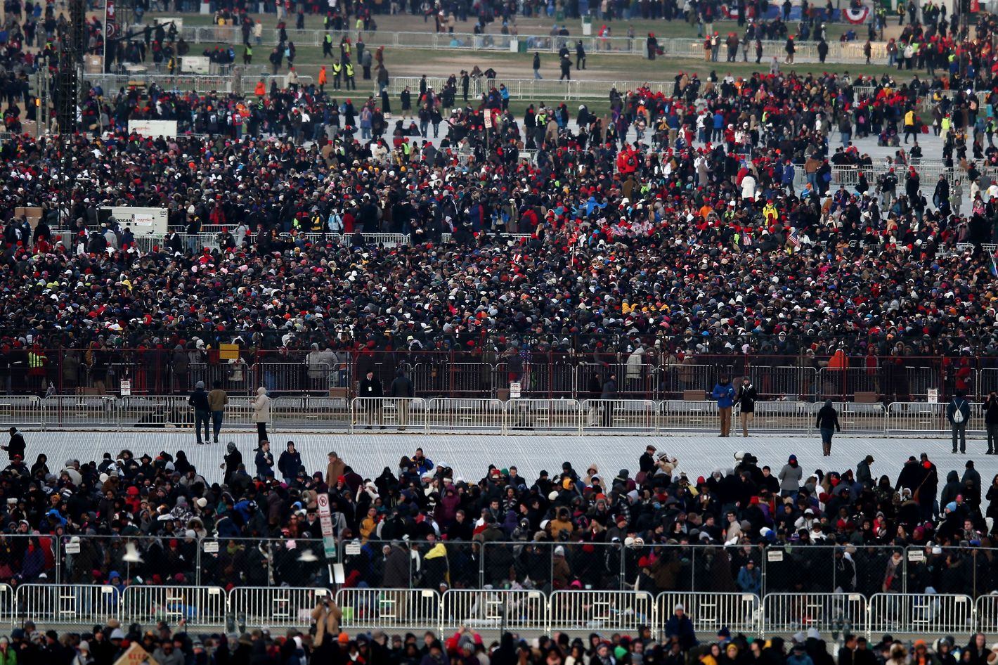 People begin to gather at the national mall before the presidential inauguration on the West Front of the U.S. Capitol January 21, 2013 in Washington, DC.   Barack Obama was re-elected for a second term as President of the United States.