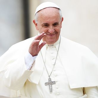 Pope Francis greets the crowd at the end of his general audience at St Peter's square on June 25, 2014 at the Vatican.