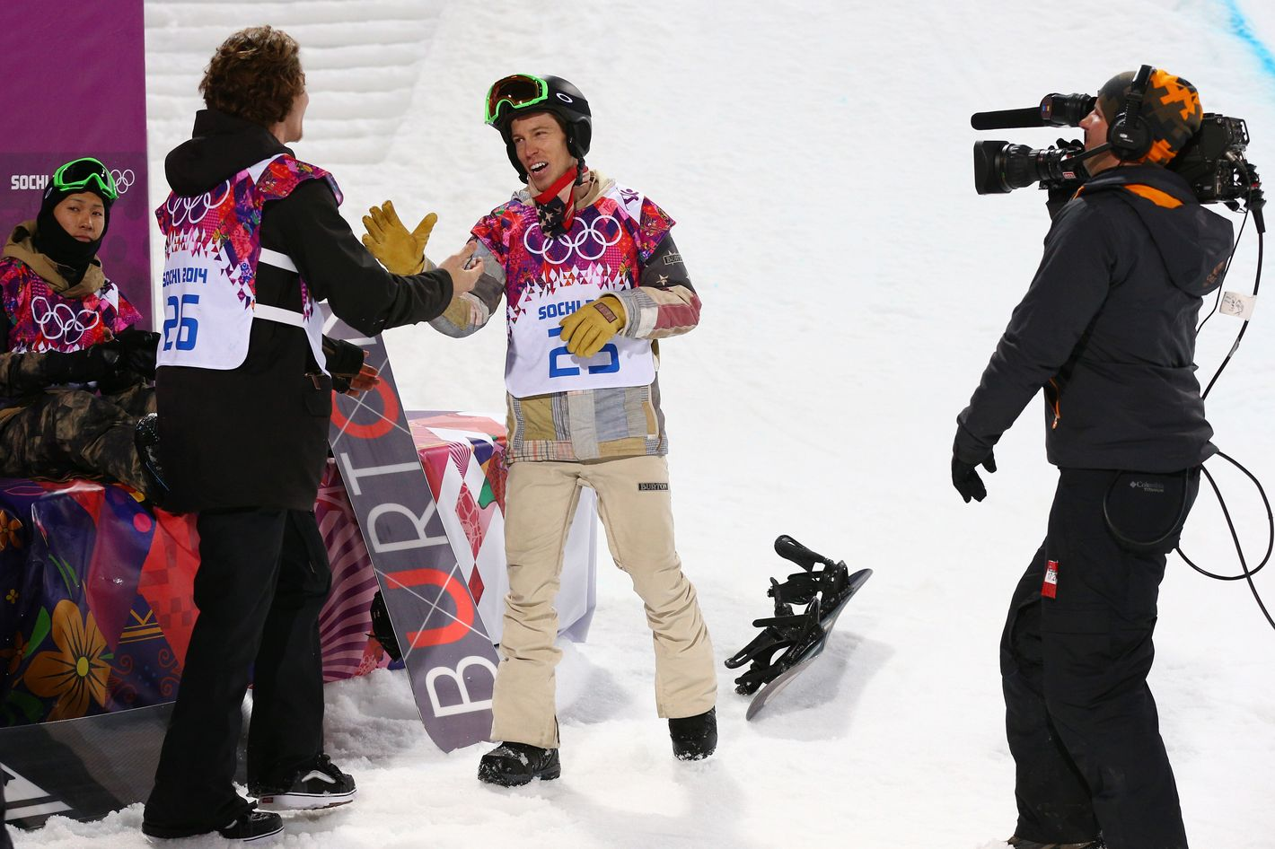 Shaun White of the United States congratulates gold medalist Iouri Podladtchikov of Switzerland after the Snowboard Men's Halfpipe Finals on day four of the Sochi 2014 Winter Olympics at Rosa Khutor Extreme Park on February 11, 2014 in Sochi, Russia.