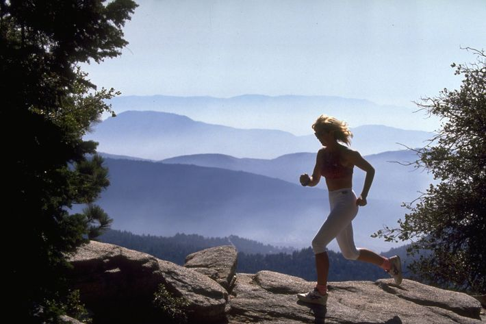 woman running in mountains - strategist best fitness gear and best workout shoes women