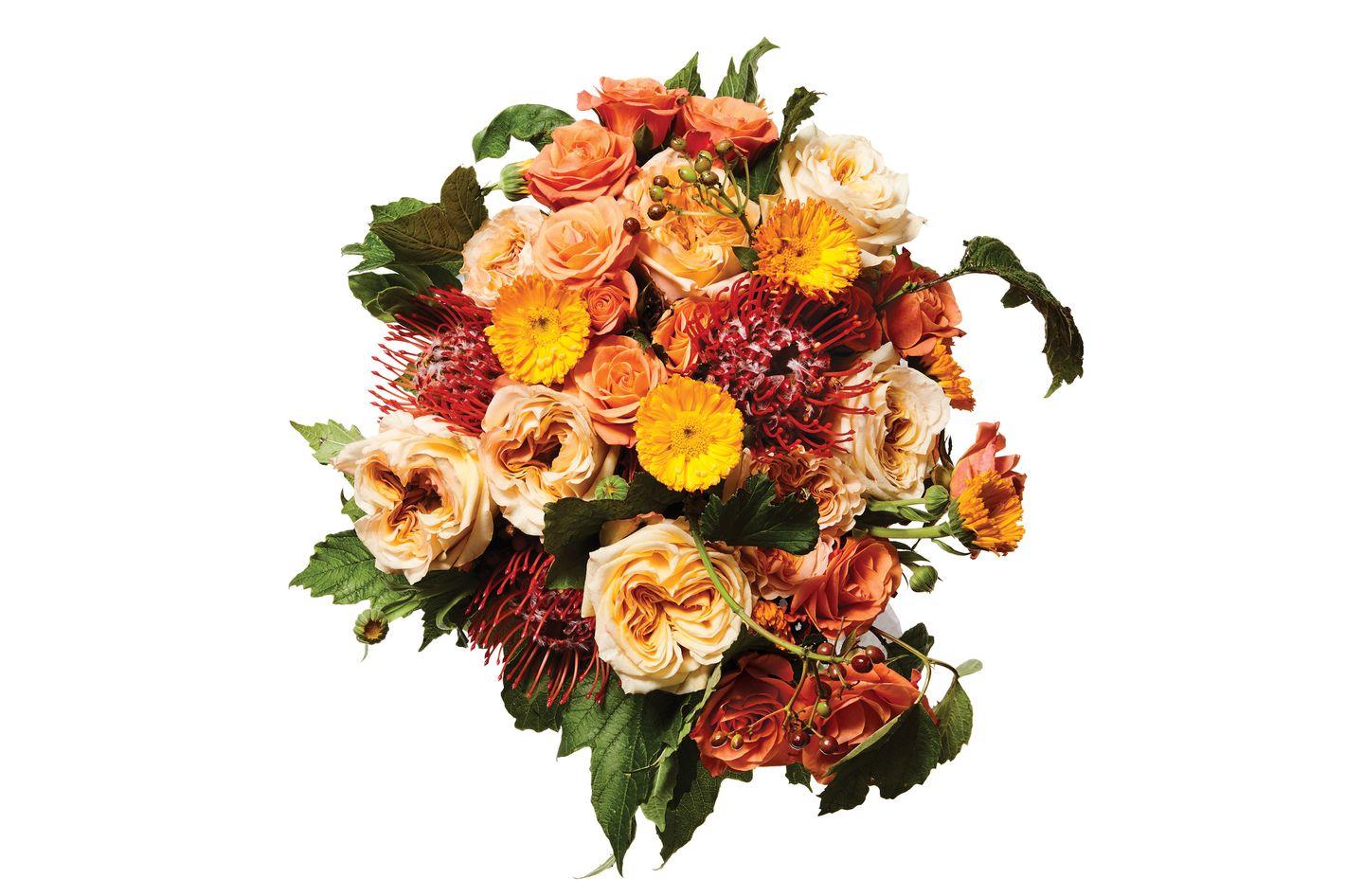 Pincushion protea, calendula, spray rose, and cranberry