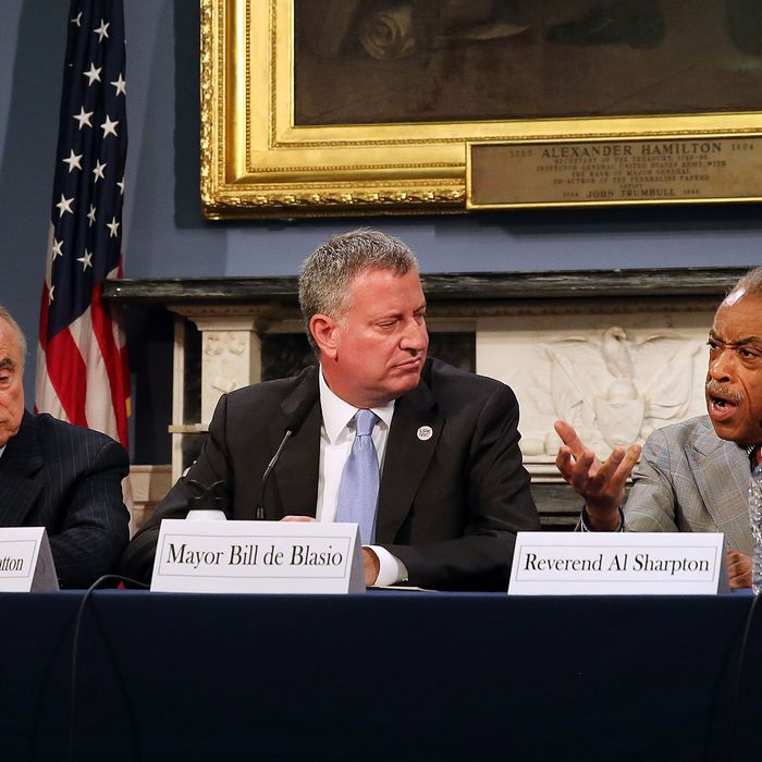 NEW YORK, NY - JULY 31: New York Mayor Bill de Blasio is joined by the Rev. Al Sharpton (right) and Police Commissioner Bill Bratton at City Hall for a roundtable discussion on police-community relations following the death of Eric Garner while in police custody in Staten Island on July 31, 2014 in New York City. The meeting included clergy members and community leaders from Staten Island and other boroughs of the city. De Blasio was elected in part as a liberal critic of the previous administration's police tactics. (Photo by Spencer Platt/Getty Images)