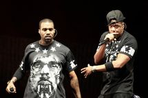 """Kanye West, left, and Jay Z perform in concert during the """"Watch The Throne"""" tour, Sunday, Nov. 6, 2011, in East Rutherford, N.J. (AP Photo/Julio Cortez)"""