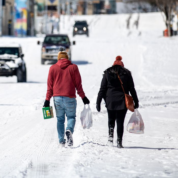 Austin residents bringing home groceries from a nearby gas station on February 15, 2021.