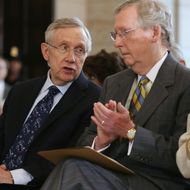 WASHINGTON, DC - JULY 18:  Senate Majority Leader Harry Reid (D-NV) (L) and Senate Minority Leader Mitch McConnell (R-KY) speak during a ceremony to celebrate the life Nobel Peace Prize laureate and former South Africa President Nelson Mandela on the occasion of his 95th birthday in the U.S. Capitol Visitor Center July 18, 2013 in Washington, DC. July 18 is Nelson Mandela Day, during which people are asked to give 67 minutes of time to charity and service in their community to honor the 67 years Mandela gave to public service. Mandela was admitted to a South African hospital June 8 where he is being treated for a recurring lung infection.  (Photo by Chip Somodevilla/Getty Images)
