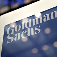 A Goldman Sachs Group Inc. logo hangs on the floor of the New York Stock Exchange in New York, U.S., on Wednesday, May 19, 2010. Goldman Sachs Group Inc. racked up trading profits for itself every day last quarter. Clients who followed the firm's investment advice fared far worse.