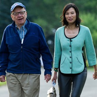 Rupert Murdoch, chairman and chief executive officer of News Corp., left, and his wife Wendi Deng arrive for the morning session at the Allen & Co. Media and Technology Conference in Sun Valley, Idaho, U.S., on Thursday, July 12, 2012. Media moguls gathered at the annual Allen & Co. conference have spent recent years contemplating how to cope with technology companies drawing audiences away from television and movies.