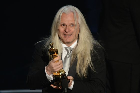 Best Cinematography winner Claudio Miranda hoists the trophy onstage at the 85th Annual Academy Awards on February 24, 2013 in Hollywood, California.