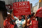 Fast-food workers striking last year.