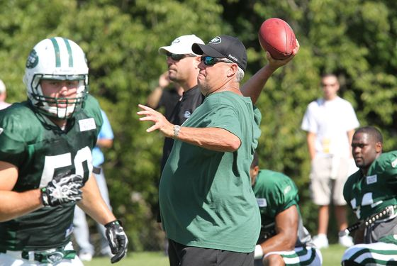 FLORHAM PARK, NJ - AUGUST 23:  Head Coach Rex Ryan of the New York Jets passes a ball during New York Jets Training Camp on August 23, 2011 in Florham Park, New Jersey.  (Photo by Al Pereira/Getty Images)