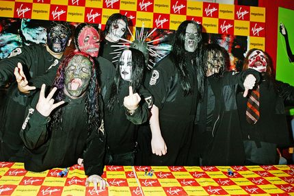 "LONDON - MAY 23:  Slipknot sign copies of their new album ""Vol 3: The Subliminal Verses"" at Virgin Megastore, Oxford Street on May 23, 2004 in London.  (Photo by Jo Hale/Getty Images)     *** Local Caption *** Slipknot"