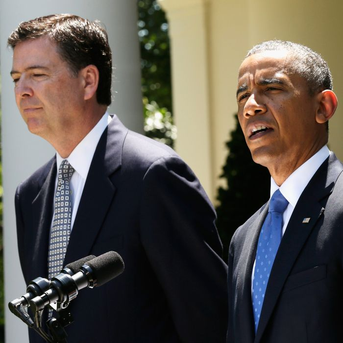 U.S. President Barack Obama (R) speaks during a news conference to announce his nomination of James Comey (L) to become FBI Director in the Rose Garden at the White House June 21, 2013 in Washington, DC. Comey, a former Justice Department official under President George W. Bush, would replace outgoing FBI Director Robert Mueller.