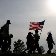 KILLEEN, TX - APRIL 04:  People participate in a flag walk in memory of those killed and injured by Iraq war veteran, Ivan Lopez, on April 4, 2014 in Killeen, Texas. Lopez killed three and wounded 16 before taking his own life on the Fort Hood Army base.  (Photo by Joe Raedle/Getty Images)