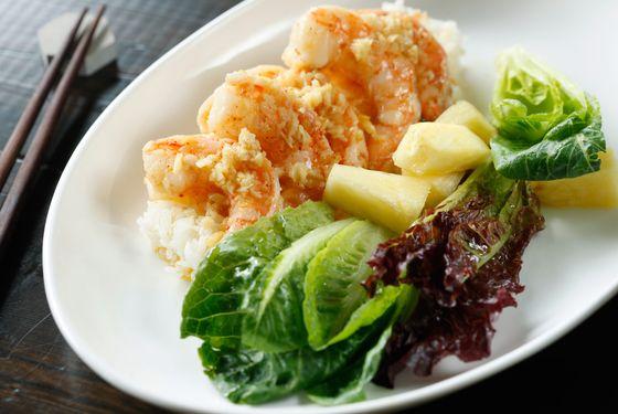Garlic shrimp over rice, romaine lettuce, pineapple.