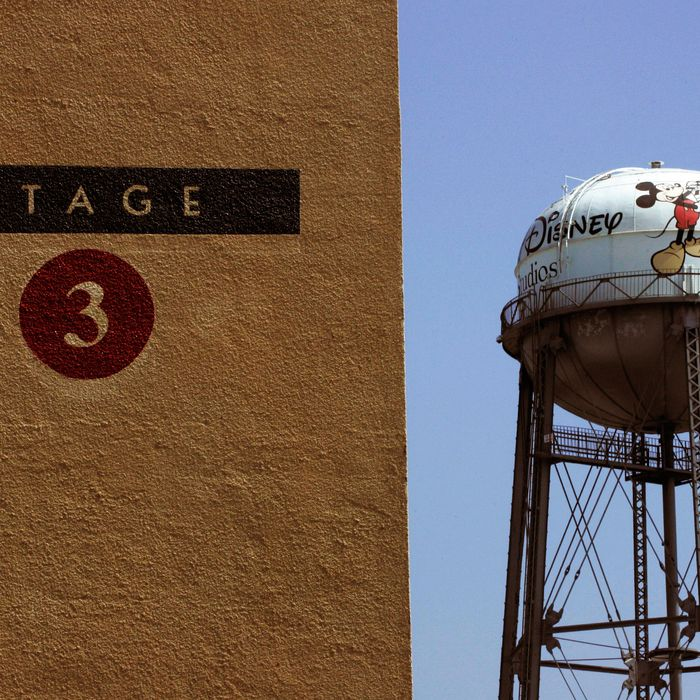 A water tower stands in the distance behind Stage 3 at Walt Disney Studios in Burbank, California, U.S., on Wednesday, June 30, 2010.