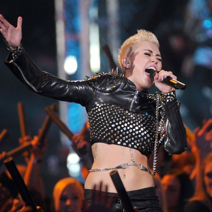 Singer Miley Cyrus performs onstage during