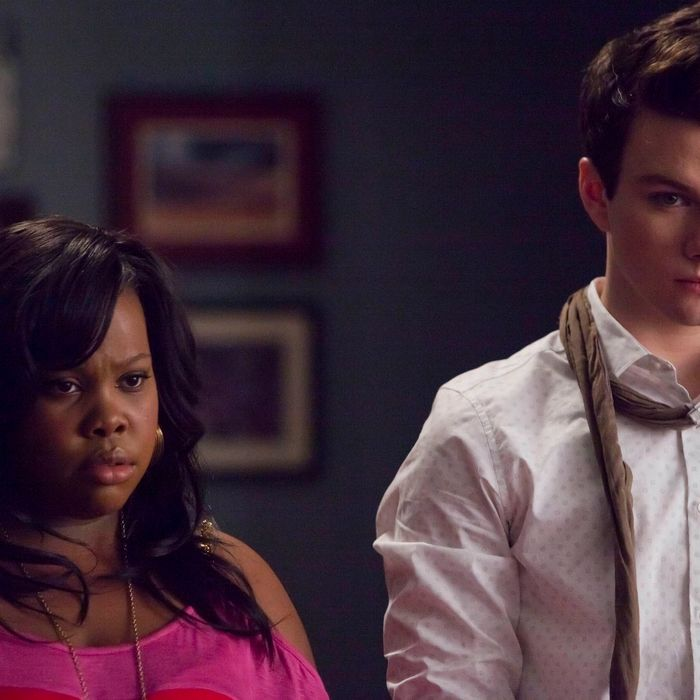 """GLEE: Mercedes (Amber Riley, L) and Kurt (Chris Colfer, R) listen to Sue's plans in the first hour of a special two-hour """"Props/Nationals"""" episode of GLEE airing Tuesday, May 15 (8:00-10:00 PM ET/PT) on FOX."""