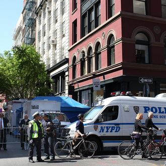 NEW YORK, NY - APRIL 19: New York City police officers watch over a crime scene where investigators searched for evidence of a six year-old boy who has been missing for 33 years April 19, 2012 in New York City. New York City police and F.B.I. investigators searched the basement of a building in New York's SoHo neighborhood for evidence of Etan Patz, a six year-old boy who disappeared 33 years ago on May 25, 1979. (Photo by Justin Sullivan/Getty Images)